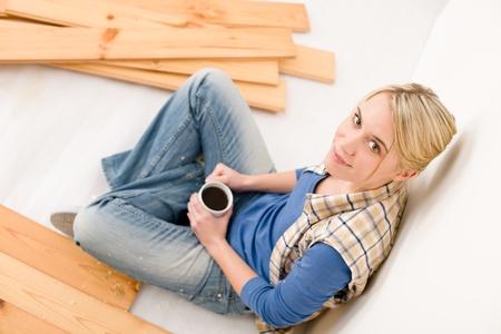 Home improvement - handywoman enjoy coffee break photo