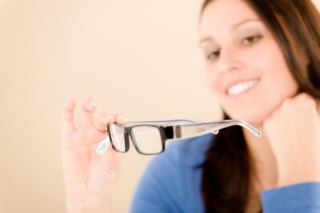 Portrait of optician client choose prescription glasses photo