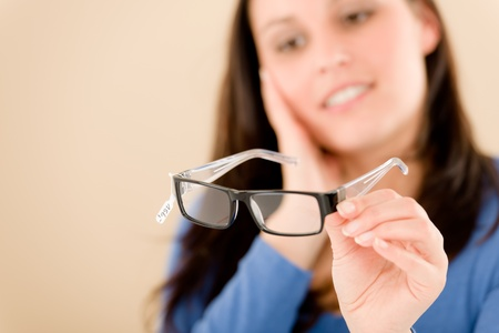 Portrait of optician client choose prescription glasses Stock Photo - 8863309