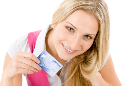 Home shopping - young woman holding credit card on white background photo