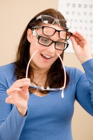 optometrist: Portrait of optician client choose prescription glasses