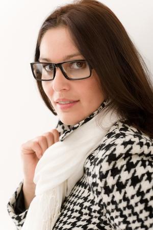 Designer glasses - winter fashion woman portrait wear coat and scarf photo