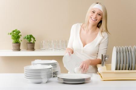 Modern kitchen - happy woman washing dishes, housework