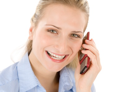 Young businesswoman on the phone on white background photo