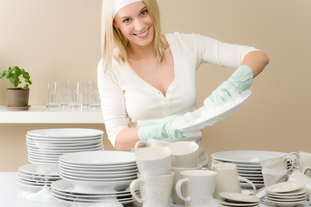 housewife gloves: Modern kitchen - happy woman washing dishes, housework