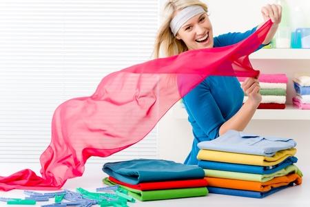 prádlo: Laundry - woman folding clothes, housework Reklamní fotografie
