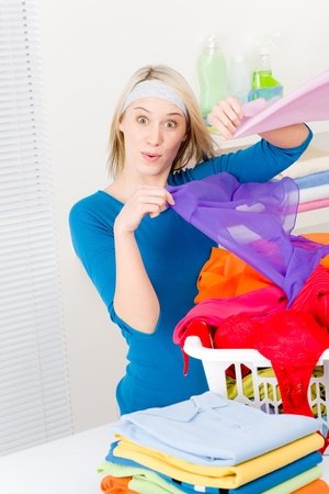 folding: Laundry - woman folding clothes home, housework
