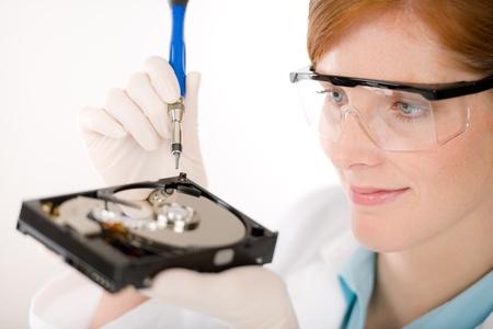 Female computer engineer - IT woman repair hard disc defect photo