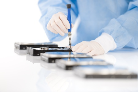Computer engineer repair hard disc defect, experiment in sterile laboratory