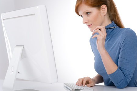 Modern office - young business woman work at computer photo