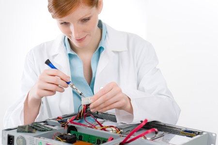 troubleshooting: Female support computer engineer - IT woman repair defect