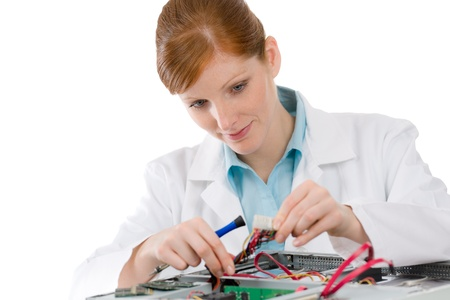 Female support computer engineer - IT woman repair defect photo