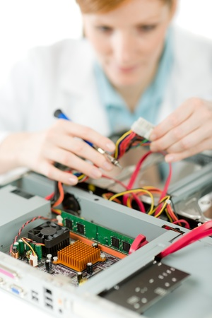 Female support computer engineer - IT woman repair defect Stock Photo - 9060744