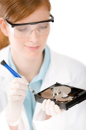 harddrive: Female computer engineer - IT woman repair hard disc defect