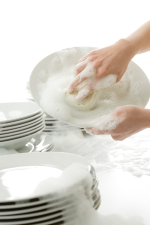 Washing dishes - hands with gloves in kitchen, housework
