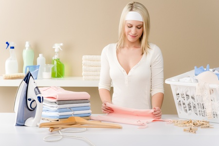Laundry ironing - woman folding clothes, housework photo