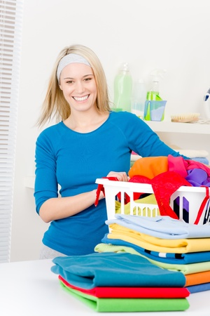 fold: Laundry - woman folding clothes home, housework