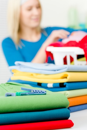 Laundry clothespin - woman in background folding clothes Stock Photo - 9061053