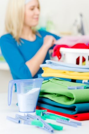 Laundry clothespin - woman in background folding clothes Stock Photo - 9061154