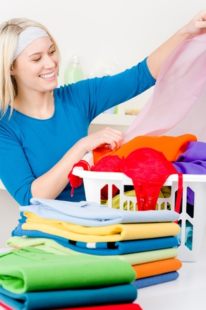 Laundry - woman folding clothes home, housework Stock Photo - 9061201