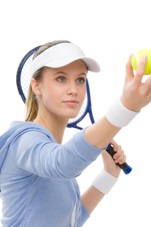 Tennis player - young woman holding racket in fitness outfit photo