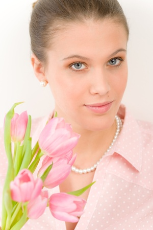 Fashion - young romantic woman with spring tulips in designer clothes photo