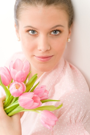 designer clothes: Fashion - young romantic woman with spring tulips in designer clothes