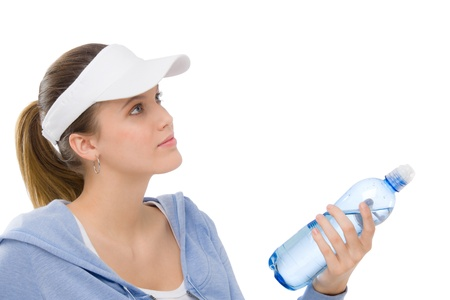Sport - young woman in summer fitness outfit with water bottle photo
