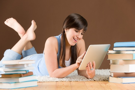 Digital touch screen computer - woman teenager study at home photo