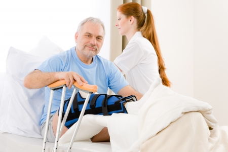 accident patient: Hospital - female nurse take care of patient with broken leg Stock Photo