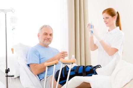 broken leg: Hospital - female nurse give injection patient with broken leg