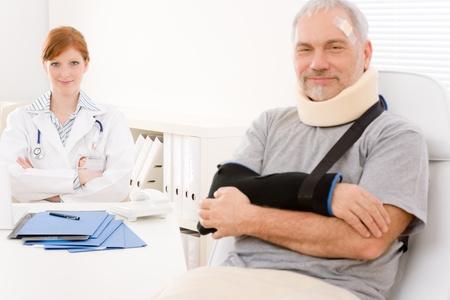 broken arm: Portrait of senior patient with broken arm in doctor office