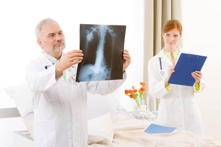 Medical team - portrait of two doctor with x-ray in hospital Stock Photo - 9248652