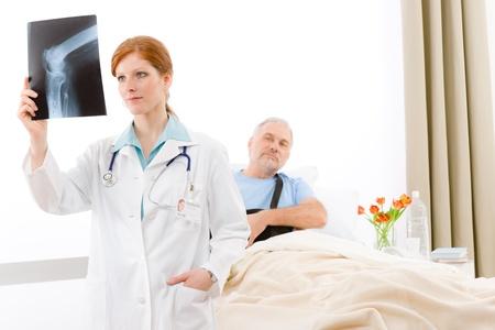 Hospital - female doctor examine x-ray of senior patient Stock Photo - 9248649