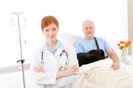 Hospital - doctor examine patient with broken arm Stock Photo - 9248646