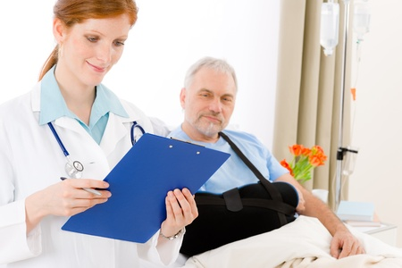 Hospital - female doctor examine senior patient with broken arm Stock Photo - 9248659