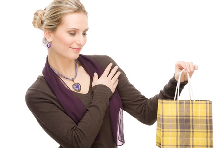 designer clothes: Portrait happy fashion woman in designer clothes with shopping bag Stock Photo