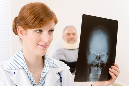 Doctor office - portrait female physician examine x-ray senior patient photo