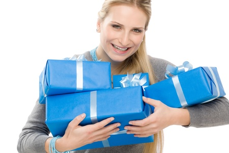 Young happy woman hold blue present with ribbon photo
