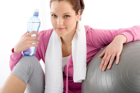 Fitness - woman relax with water bottle exercise ball Stock Photo - 9266176