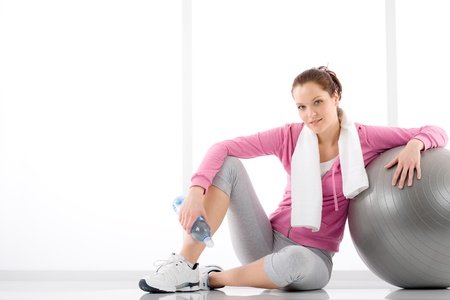 Fitness - woman relax with water bottle exercise ball Stock Photo - 9266127