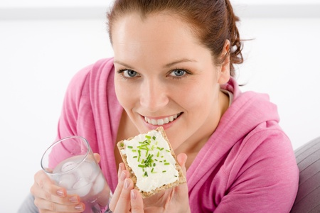 Fitness - woman relax with glass water snack on white Stock Photo - 9266170