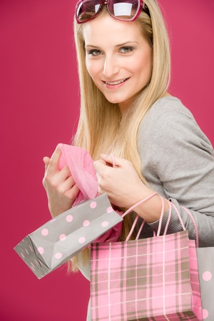 Portrait happy fashion woman in designer clothes with shopping bag photo