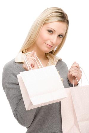 designer bag: Mujer de moda feliz de retrato en ropa con bolsa de compras Foto de archivo
