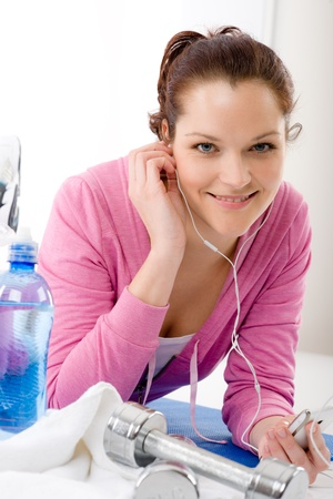 Fitness woman listen music mp3 relax gym on white background Stock Photo - 9319031