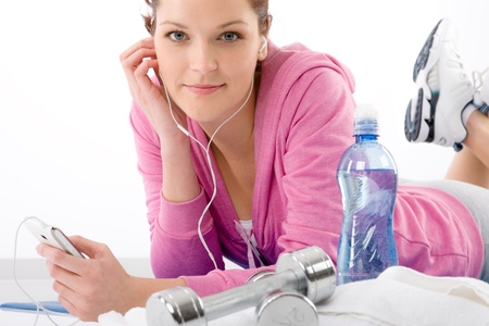 Fitness woman listen music mp3 relax gym on white background Stock Photo - 9318743