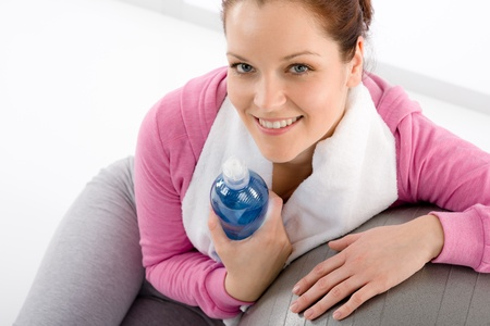 Fitness woman relax water bottle ball sportive outfit Stock Photo - 9318744