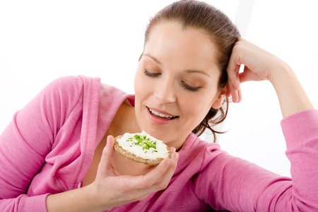 Fitness happy woman eat snack sportive outfit in gym photo