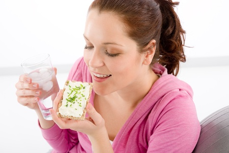 Fitness woman relax with glass water snack sportive outfit Stock Photo - 9318747
