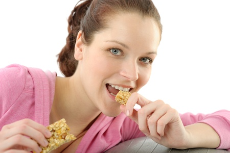 Fitness woman eat granola bar sportive outfit in gym Stock Photo - 9318742